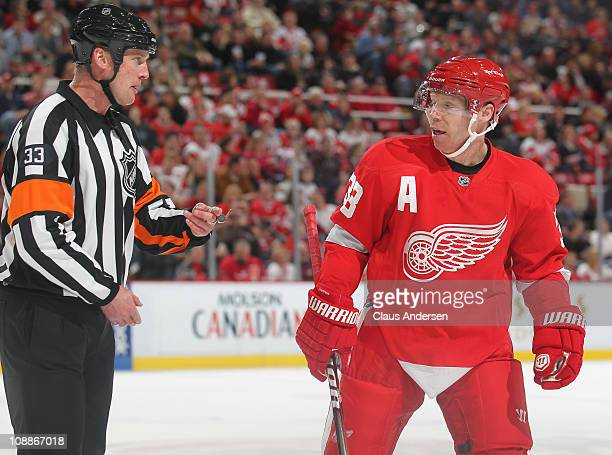 Referee Kevin Pollock doesn't seem to want to listen to anything Kris Draper of the Detroit Red Wings has to say in a game against the Columbus Blue...