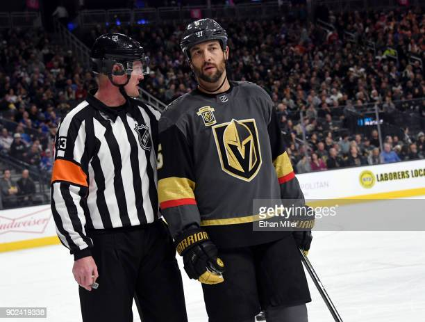 Referee Kevin Pollock talks with Deryk Engelland of the Vegas Golden Knights in the first period of the Golden Knights' game against the New York...