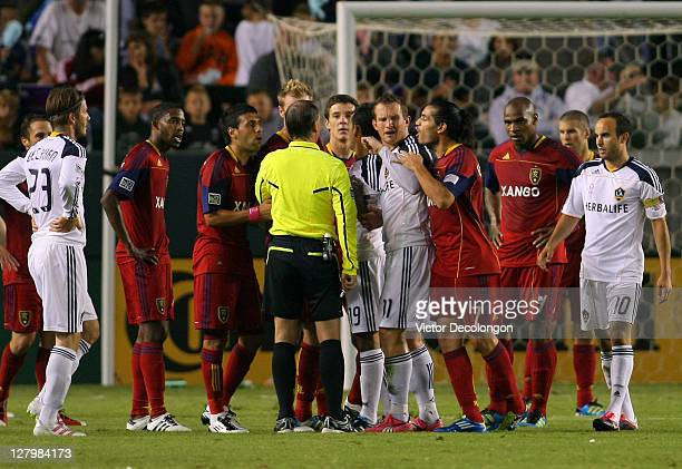 Referee Kevin Stott stands surrounded by players from Real Salt Lake and the Los Angeles Galaxy during their MLS match at The Home Depot Center on...