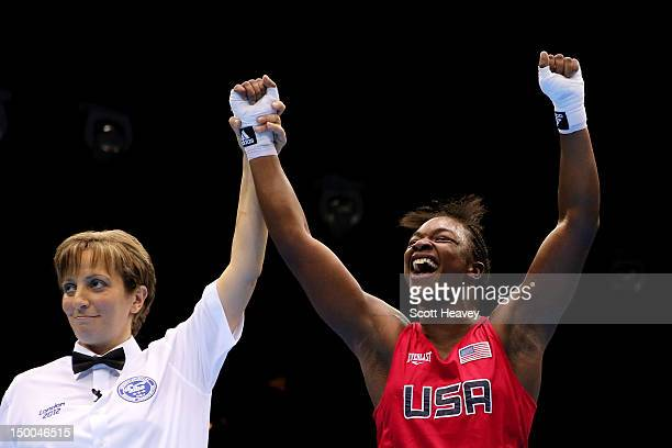 Referee Kheira Sidi Yakoub announces Claressa Shields of the United States winner over Nadezda Torlopova of Russia during the Women's Middle Boxing...