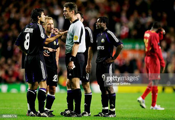 Referee Kim Milton Neilsen sends of Nenad Jestrovic of Anderlecht for alleged racial abuse towards Mohamed Sissoko of Liverpool during the UEFA...