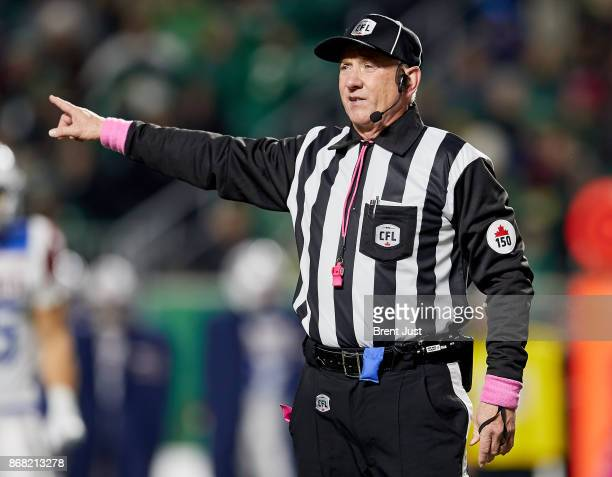CFL referee Kim Murphy makes a call in the game between the Montreal Alouettes and Saskatchewan Roughriders at Mosaic Stadium on October 27 2017 in...