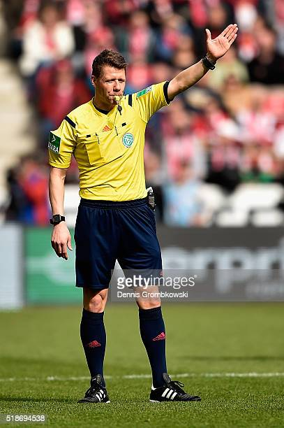Referee Knut Kircher gestures during the Bundesliga match between 1 FSV Mainz 05 and FC Augsburg at Coface Arena on April 2 2016 in Mainz Germany