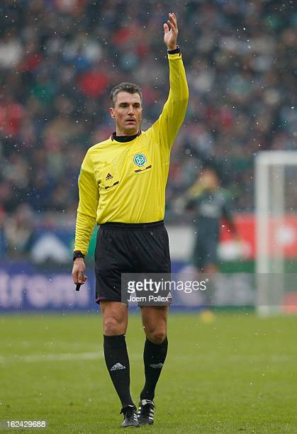 Referee Knut Kircher gestures during the Bundesliga match between Hannover 96 and Hamburger SV at AWD Arena on February 23 2013 in Hannover Germany