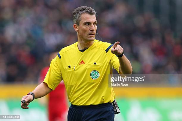Referee Knut Kircher gestures during the Bundesliga match between Borussia Moenchengladbach and 1 FC Koeln at BorussiaPark on February 20 2016 in...