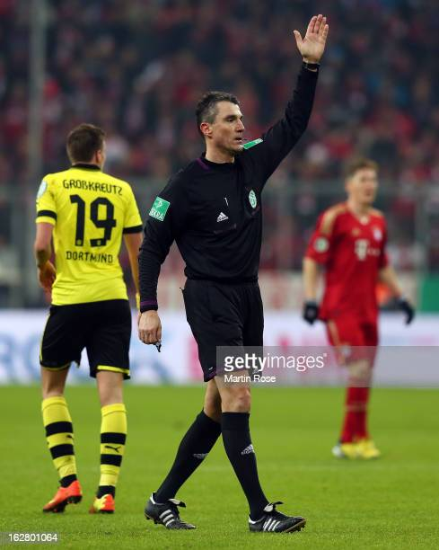 Referee Knut Kircher gestures during the DFB cup quarter final match between Bayern Muenchen and Borussia Dortmund at Allianz Arena on February 27...