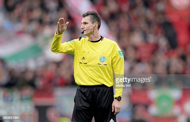 Referee Knut Kircher reacts during the Bundesliga match between 1 FC Nuernberg and Eintracht Frankfurt at Grundig Stadium on March 23 2014 in...