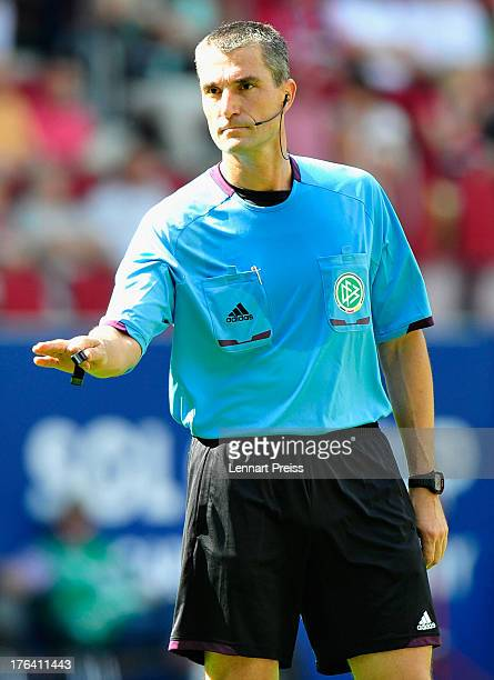Referee Knut Kircher reacts during the Bundesliga match between FC Augsburg and Borussia Dortmund at SGL Arena on August 10 2013 in Augsburg Germany
