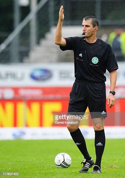 Referee Knut Kircher reacts during the third Bundesliga match between Stuttgarter Kickers and VfB Stuttgart II at GAZIStadion on August 25 2013 in...