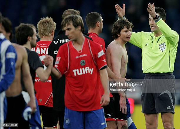 Referee Knut Kircher speaks to Michael Tarnat of Hannover during the Bundesliga match between Hannover 96 and Bayer Leverkusen at the AWD Arena on...