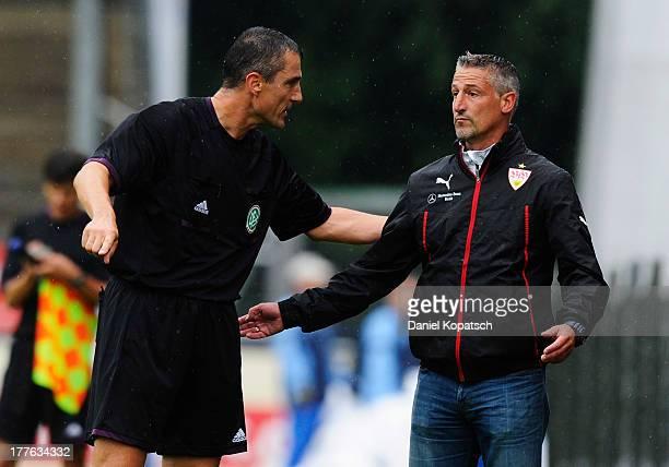 Referee Knut Kircher talks to Coach Juergen Kramny of Stuttgart during the third Bundesliga match between Stuttgarter Kickers and VfB Stuttgart II at...
