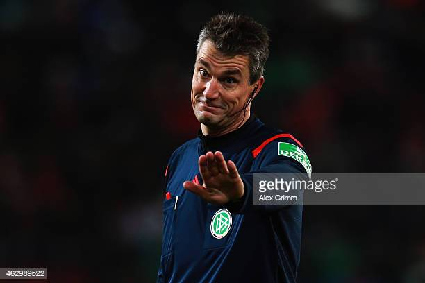Referee Knut Kircher whistles during the Bundesliga match between FC Augsburg and Eintracht Frankfurt at SGL Arena on February 8 2015 in Augsburg...