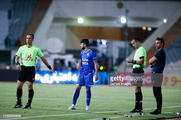 Referee Komeil Gholami and Head Coach Farhad Majidi of Esteghlal looks on during the Persian Gulf Pro League match between Esteghlal and Padideh FC...