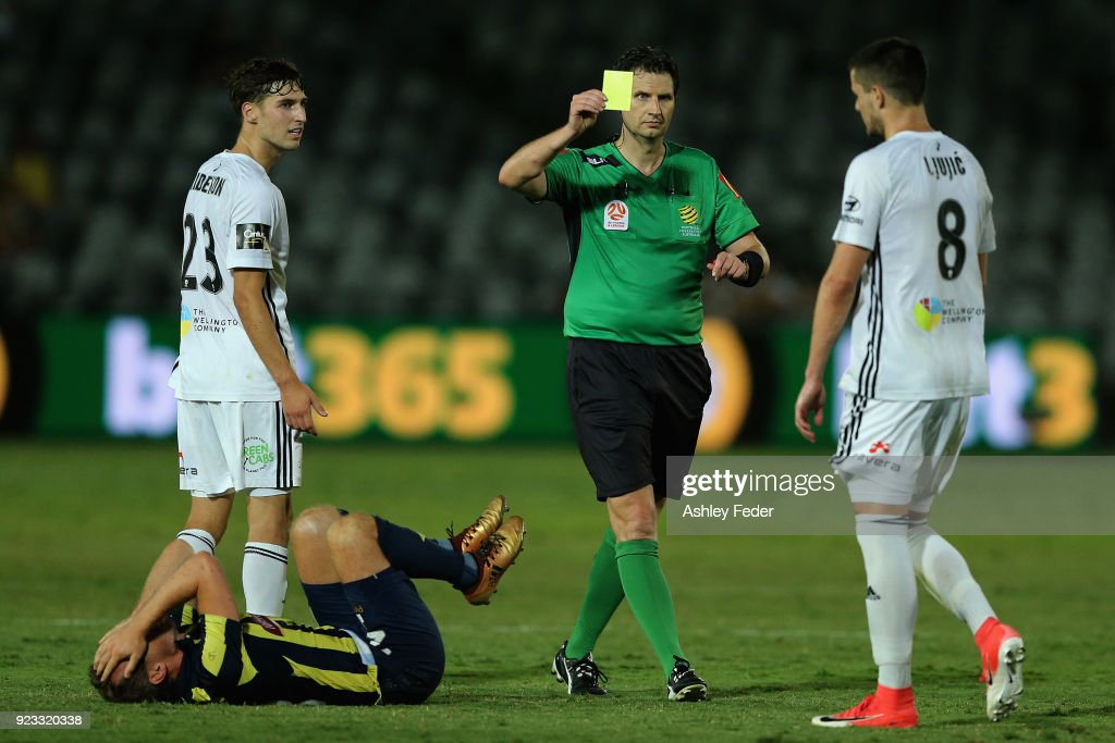 Referee Kris Griffith-Jones shows a yellow card to Matija Ljujic of the Phoenix for a foul against Wout Brama of the Mariners during the round 21 A-League match between the Central Coast Mariners and the Wellington Phoenix at Central Coast Stadium on February 23, 2018 in Gosford, Australia.