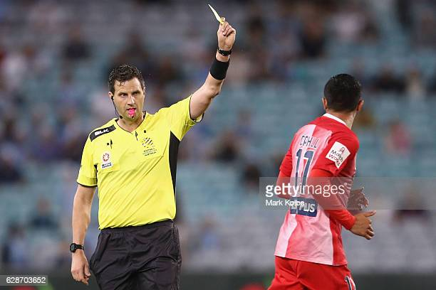 Referee Kris GriffithJones shows Tim Cahill of Melbourne City a is shown a yellow card card during the round 10 ALeague match between Sydney FC and...
