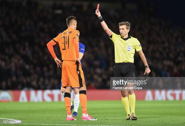Referee Kristo Tohver awards Yevhen Shakhov of PAOK FC a red card for a foul on Olivier Giroud of Chelsea during the UEFA Europa League Group L match...