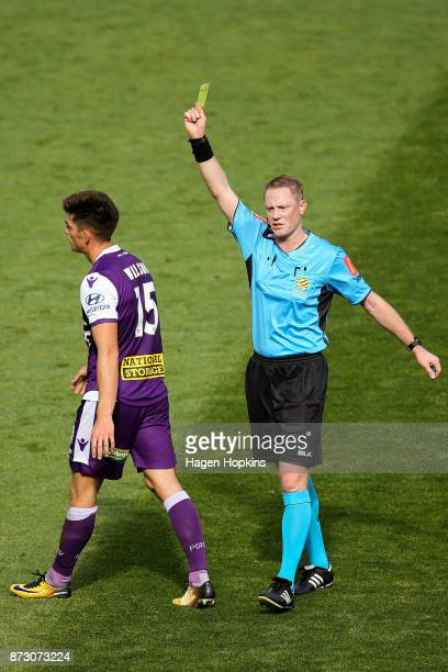 Referee Kurt Ams shows a yellow card to Brandon Wilson of the Glory during the round six ALeague match between the Wellington Phoenix and the Perth...