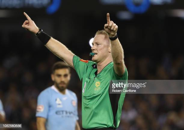 Referee Kurt Ams signals for the VAR during the round one ALeague match between Melbourne Victory and Melbourne City at Marvel Stadium on October 20...