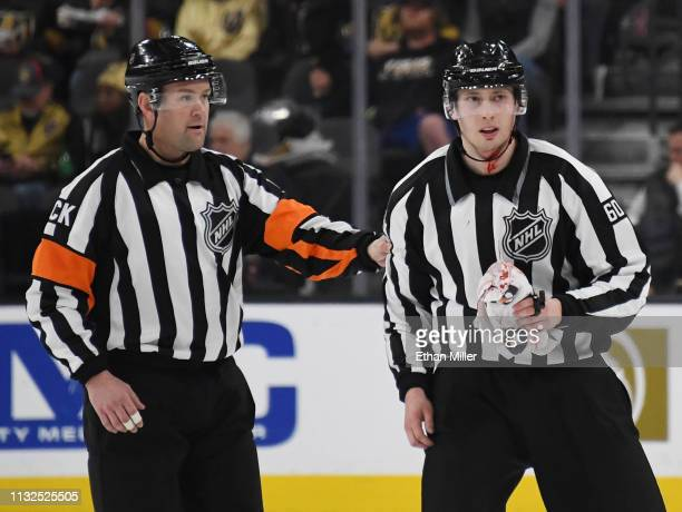 Referee Kyle Rehman directs linesman Libor Suchanek to get treated for an injury during a game between the Dallas Stars and the Vegas Golden Knights...