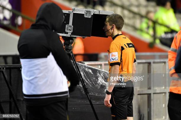 referee Lardot Jonathan looks at the video assistance during the Croky Cup final match between KRC Genk and Standard de Liege on March 17 2018 in...