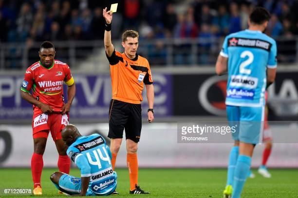 referee Lardot Jonathan shows a yellow card to Anderson Esiti midfielder of KAA Gent during the Jupiler Pro League Play Off 1 match between KAA Gent...