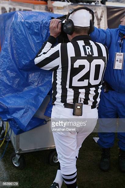 Referee Larry Nemmers looks at a replay during the Green Bay Packers game against the Chicago Bears at Soldier Field on December 4 2005 in Chicago...