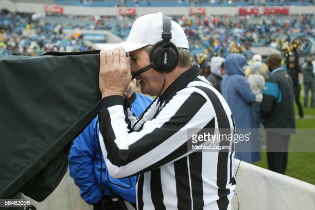 Referee Larry Nemmers reviews an instant replay during the game between the San Francisco 49ers and the Jacksonville Jaguars on December 18 2005 at...