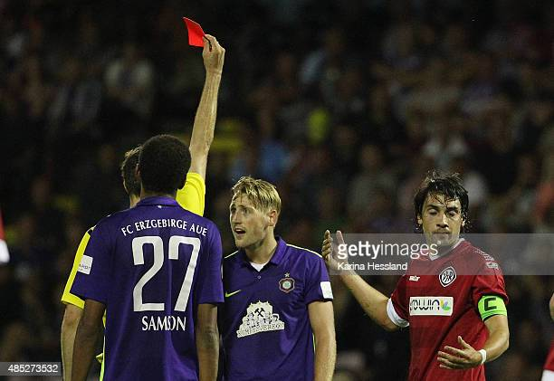 Referee Lasse Koslowski shows the red card to Bjoern Kluft of Aue during the Third League match between FC Erzgebirge Aue and VFR Aalen at...