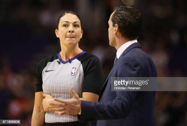 Referee Lauren Holtkamp talks with head coach Kenny Atkinson of the Brooklyn Nets during the first half of the NBA game against the Phoenix Suns at...
