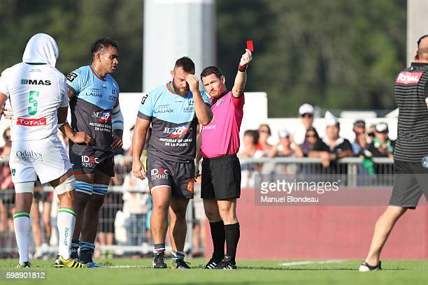 Referee Laurent Cardona shows a red card to Jerome Schuster of Bayonne during the French Top 14 match between Pau and Bayonne on September 3 2016 in...