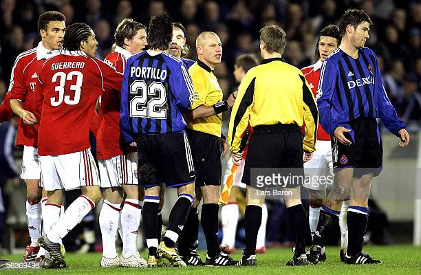 Referee Laurent Duhamel of France talks with players after the Champions League Group A match between Club Bruges and Bayern Munich at the Jan...