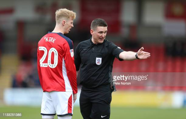 Referee Lee Collins makes a point to Charlie Kirk of Crewe Alexandra during the Sky Bet League Two match between Crewe Alexandra and Northampton Town...