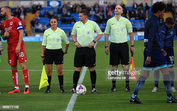 Referee Lee Collins with assistants Marvyn Amphlett and Lisa Rashid during the EFL Cup match between Wycombe Wanderers and Bristol City at Adams Park...