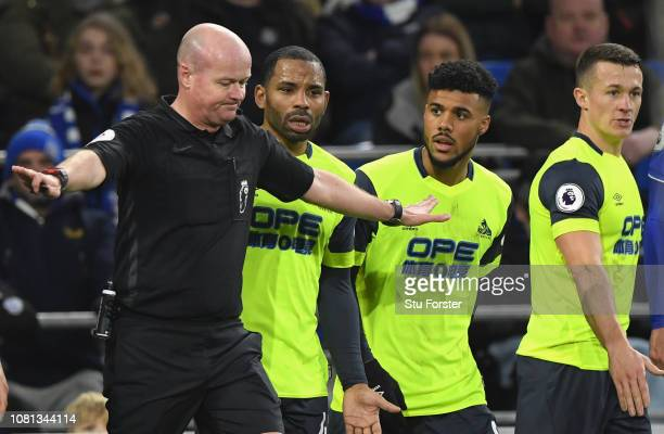 Referee Lee Mason changes his mind over awarding Huddersfield a penalty as the Huddersfield players react to the news during the Premier League match...
