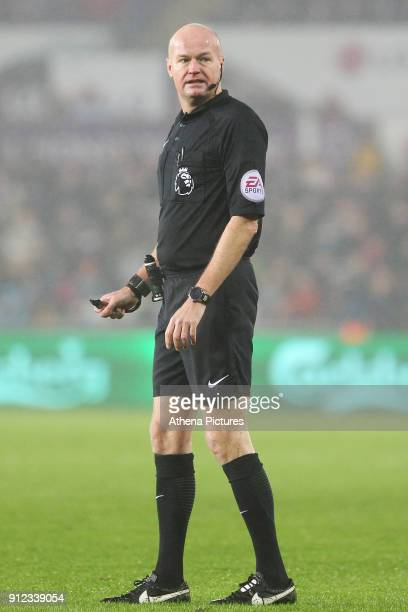 Referee Lee Mason during the Premier League match between Swansea City and Arsenal at the Liberty Stadium on January 30 2018 in Swansea Wales