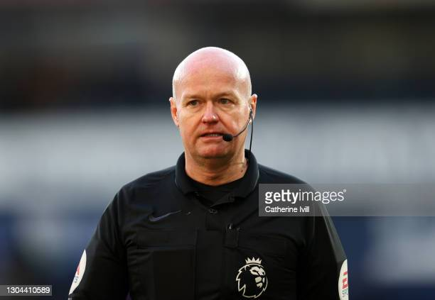 Referee Lee Mason during the Premier League match between West Bromwich Albion and Brighton & Hove Albion at The Hawthorns on February 27, 2021 in...