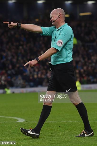 Referee Lee Mason gestures during the English Premier League football match between Burnley and Arsenal at Turf Moor in Burnley north west England on...