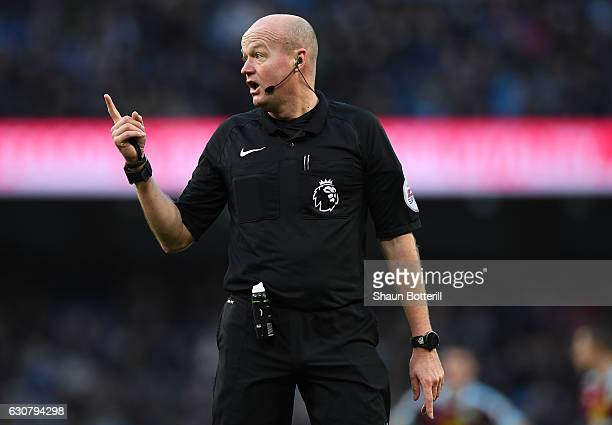 Referee Lee Mason gestures during the Premier League match between Manchester City and Burnley at Etihad Stadium on January 2 2017 in Manchester...