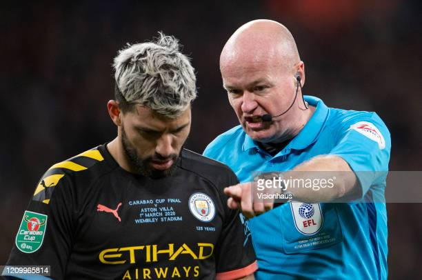 Referee Lee Mason instructs Sergio Aguero of Manchester City to leave the pitch at the nearest point during the Carabao Cup Final between Aston Villa...