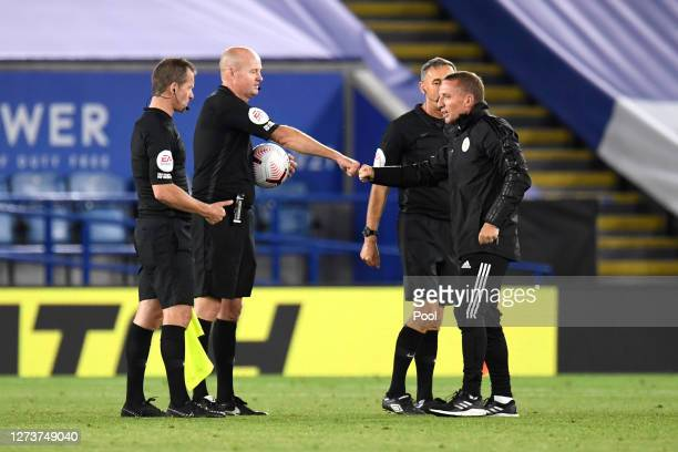Referee Lee Mason interacts with Brendan Rogers Manager of Leicester City following the Premier League match between Leicester City and Burnley at...