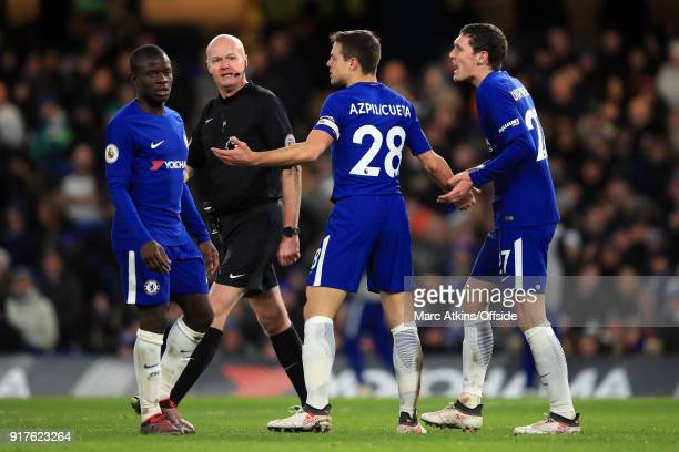 Referee Lee Mason is surrounded by N'Golo Kante Cesar Azpilicueta and Andreas Christensen of Chelsea during the Premier League match between Chelsea...