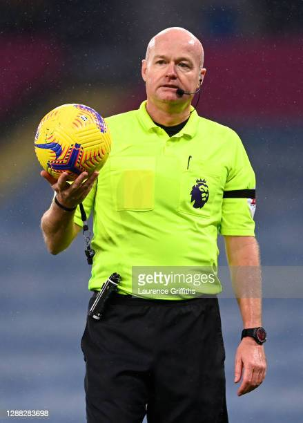 Referee Lee Mason looks on during the Premier League match between Manchester City and Burnley at Etihad Stadium on November 28 2020 in Manchester...