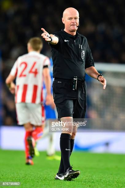Referee Lee Mason officiates during the English Premier League football match between Brighton and Hove Albion and Stoke City at the American Express...