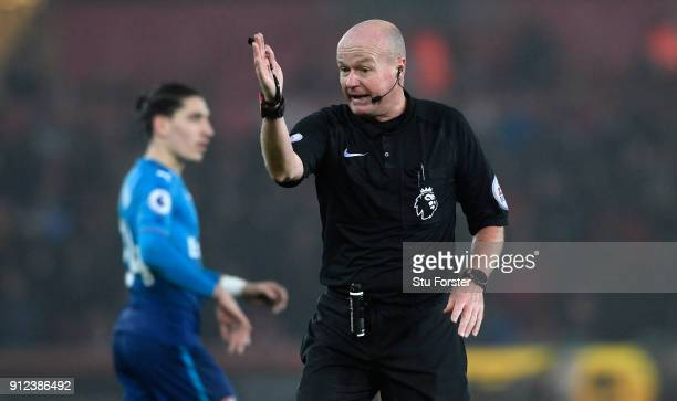 Referee Lee Mason reacts during the Premier League match between Swansea City and Arsenal at Liberty Stadium on January 30 2018 in Swansea Wales