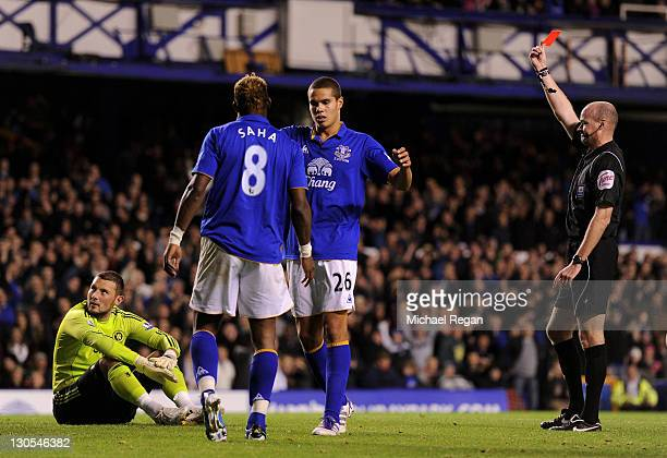 Referee Lee Mason sends off Ross Turnbull of Chelsea following his foul on Louis Saha of Everton during the Carling Cup Fourth Round match between...