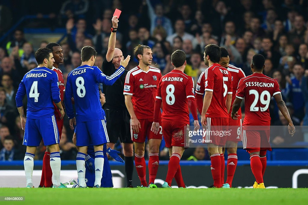 Referee Lee Mason shows Claudio Yacob of West Brom a red card during the Barclays Premier League match between Chelsea and West Bromwich Albion at Stamford Bridge on November 22, 2014 in London, England.