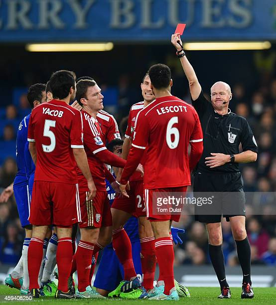 Referee Lee Mason shows Claudio Yacob of West Brom a red card during the Barclays Premier League match between Chelsea and West Bromwich Albion at...