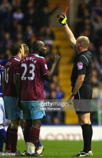 Referee Lee Mason shows the red card tro Mark Noble of West Ham United during the Barclays Premier League match between Birmingham City and West Ham...