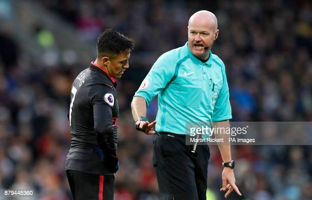 Referee Lee Mason speaks with Arsenal's Alexis Sanchez during the Premier League match at Turf Moor Burnley