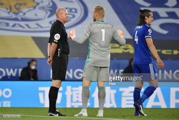 Referee Lee Mason speaks with Kasper Schmeichel of Leicester City during the Premier League match between Leicester City and Burnley at The King...